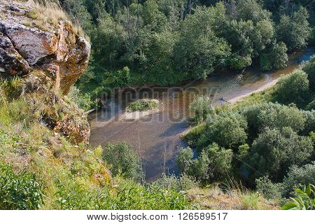 beautiful rock on the river summer day, Russia