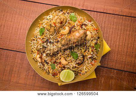 chicken biryani prepared in basmati rice with leg piece