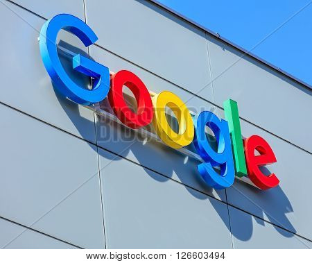 Zurich, Switzerland - 20 April, 2016: Google sign on the wall of the Google office building. Google is a multinational technology company specializing in Internet-related services and products.