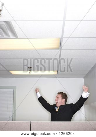 Businessman Raises His Arms In Success