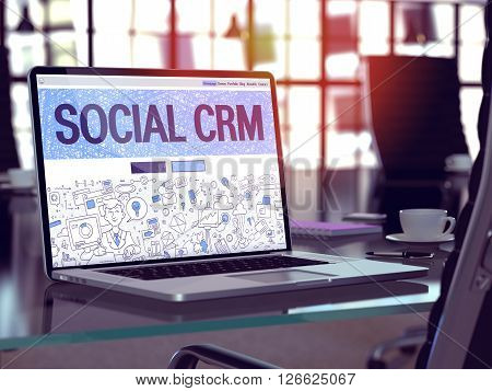 Modern Workplace with Laptop Showing Landing Page in Doodle Design Style with Text Social CRM. Toned Image with Selective Focus. 3D Render.