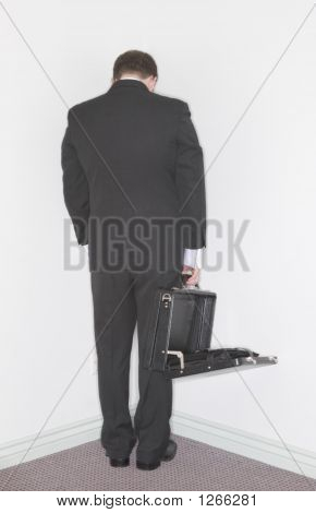 Businessman Stands In The Corner