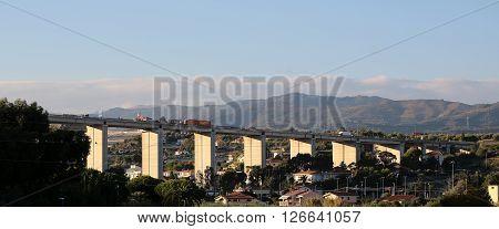 Monte Carlo Monaco - September 21 2015: highway bridge hideaway above residential buildings houses on mountain scene