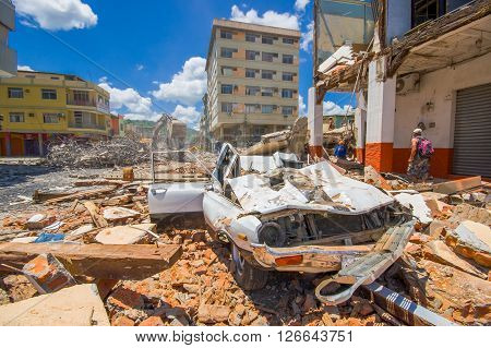 Portoviejo, Ecuador - April, 18, 2016: Collapsed car, showing the aftereffect of 7.8 earthquake that destroyed the city center.