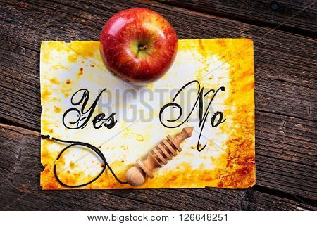 Pendulum, tool for dowsing, on yes and no choosing diagram with apple. Pointing No. Search for my other photo with pendulum pointing Yes.