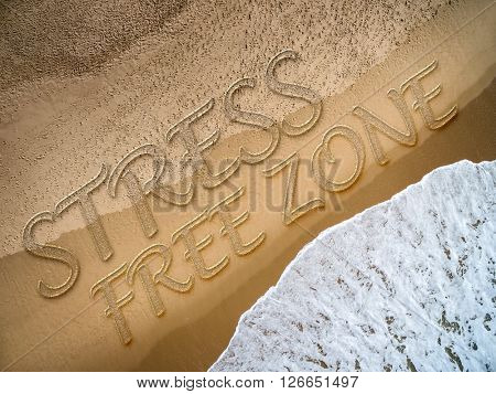 Stress Free Zone written on the beach