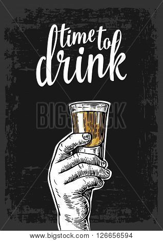 Male hand holding a shot of alcohol drink. Vintage vector engraving illustration for label poster invitation to a party. Time to drink. Dark background
