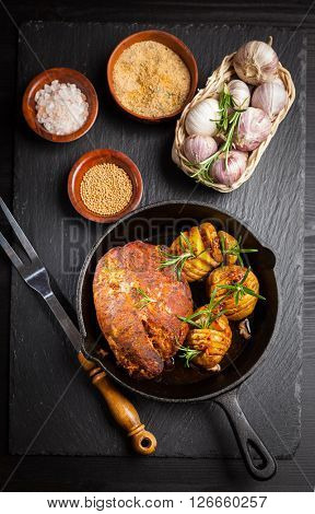 Pulled pork dish with backed rustic potates and spices
