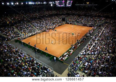 CLUJ-NAPOCA, ROMANIA - APRIL 17, 2016: Crowd of people supporting their favorites during a Fed Cup tennis match in the World Cup Play-Offs, Romania vs Germany