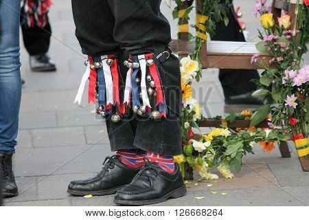 Ribbons and bells on Morris dancers legs while dancing