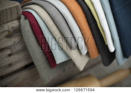 Layers Of Folded Cotton Fabric Hanging On Crate