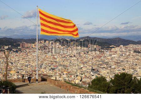 BARCELONA CATALONIA SPAIN - DECEMBER 14 2011: Catalan flag fluttering in the wind in Montjuic Castle poster