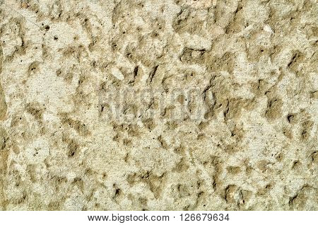 Rough uneven stone surface with fine grooves. Stone textured background.