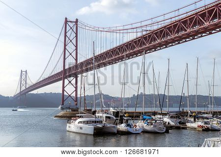 The 25 de Abril Bridge is a suspension bridge connecting the city of Lisbon capital of Portugal to the municipality of Almada on the left bank of the Tejo river.
