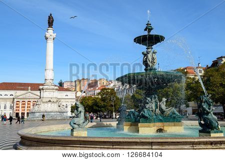 LISBON PORTUGAL - FEBRUARY 03 2016: The bronze fountain at the Rossio Square in Lisbon Portugal