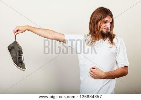 Man With Stinky Shoe