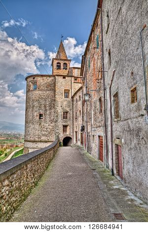 picturesque old alley with underpass under the Saint Augustine church in the medieval village Anghiari, Arezzo, Tuscany, Italy