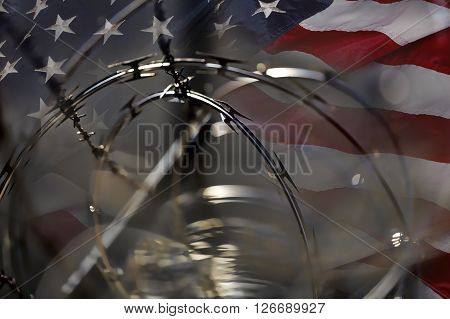 USA Border fence barb razor wire and American Flag Immigration Concept photograph