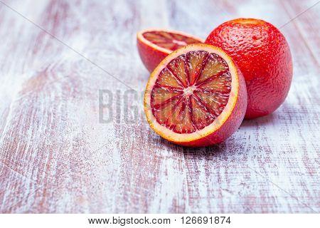 Sicilian orange isolated on a wood background