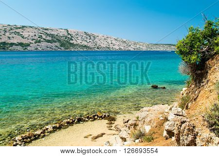 The crystal clear sea surrounding the island of Rab Croatian tourist resort.