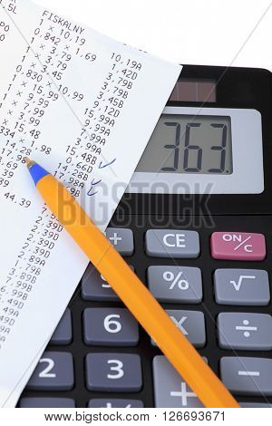 A calculator with receipt, household bills