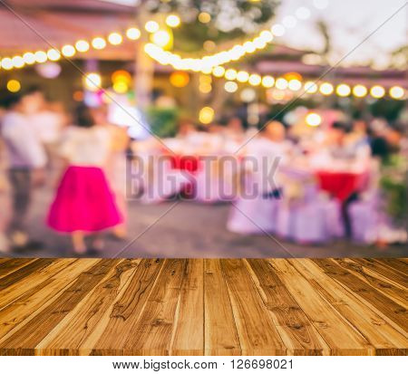 wood texture and event Party with People Blurred Background