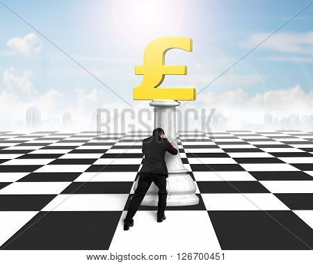 Man pushing money chess of golden pound currency on chessboard with sun sky clouds background.