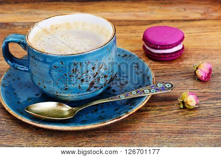Sweet  French Macaroons with Cofee Cup. Studio Photo