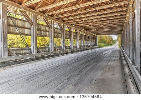 Viewed from the inside Ashtabula County Ohio's Giddings Road Covered Bridge is a relatively new span built in 1995.