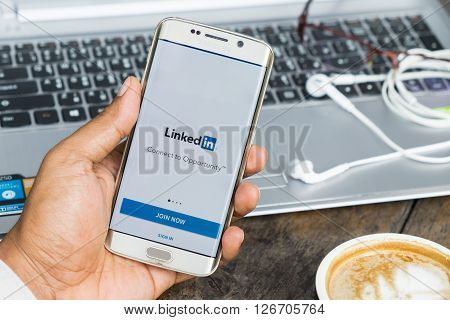 CHIANG MAI THAILAND - MAR 092016: Man hand holding samsung galaxy s6 edge with LinkedIn application on the screen. LinkedIn is a business-oriented social networking service.