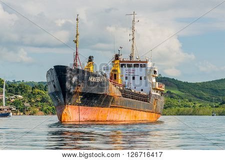 Hell-Ville Madagascar - December 19 2015: General Cargo Ship Muneera (formerly known as Semlow) anchored at Hell-Ville Nosy Be Island Madagascar. On 2005 pirates seized control of MV Semlow as it was ferrying 850 tonnes of German- and Japanese-donated ric