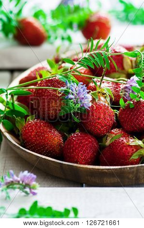Close up of fresh organic strawberry on wooden background selective focus vertical