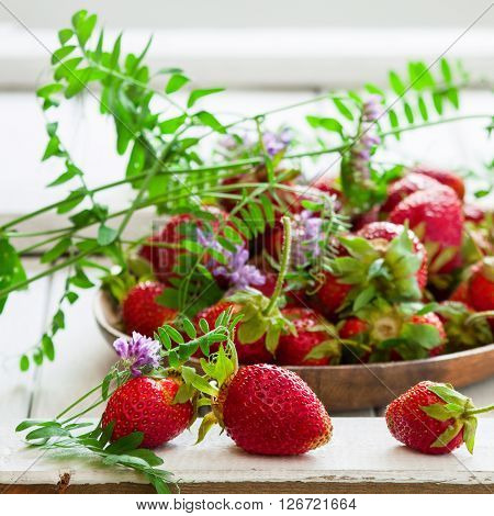 Fresh organic strawberry on wooden background selective focus square image
