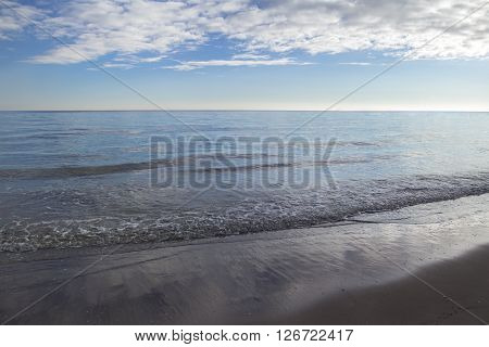 Sea landscape with stratocumulus clouds on warm sunset heaven