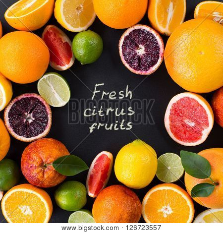"""""""Fresh citrus fruits"""" poster. Set of ripe citrus fruit with leaves on a black background. Grapefruit, orange, lime, lemon, red orange. View from above poster"""