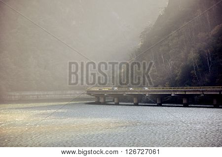 Morning landscape in the defile. Viaduct over the river