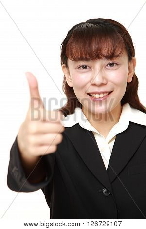 studio shot of businesswoman with thumbs up gesture on white background