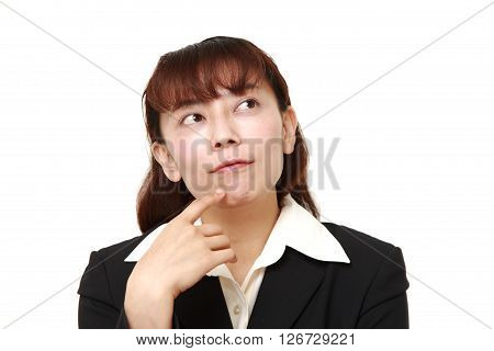Asian businesswoman thinks about something on white background