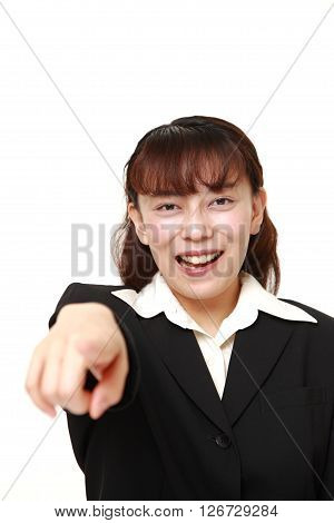 Asian businesswoman discover something on white background