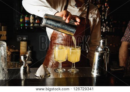 Bartender is making cocktails at the bar counter