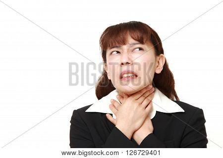 studio shot of Asian businesswoman having throat pain on white background