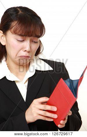 studio shot of poor businesswoman on white background