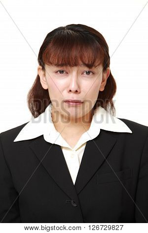 studio shot of sad businesswoman on white background