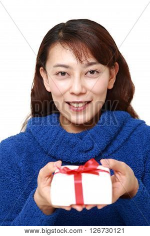 studio shot of Asian woman offering a gift on white background