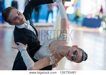 Minsk Belarus -April 3 2016: Kovalevskiy Denis and Antipenko Nadezhda Perform Youth-2 Standard Program on the IDSA Championship Kinezis Star Cup - 2016 in April 3 2016 in Minsk Republic of Belarus