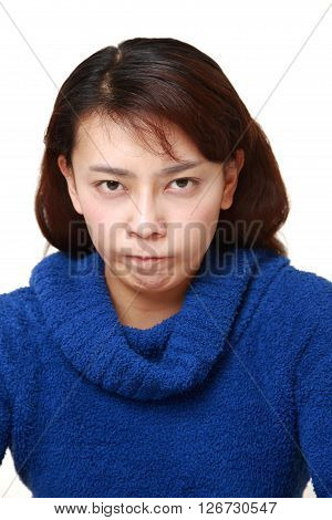 studio shot of angry woman on white background