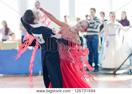 Minsk Belarus -April 3 2016: Egorov Vladislav and Chaplinskaya Tatiana Perform Youth-2 Standard Program on the IDSA Championship Kinezis Star Cup - 2016 in April 3 2016 in Minsk Republic of Belarus