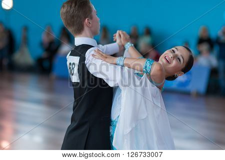Minsk Belarus -April 3 2016: Levkovich Aleksander and Bugakova Evelina Perform Youth-2 Standard Program on the IDSA Championship Kinezis Star Cup - 2016 in April 3 2016 in Minsk Republic of Belarus