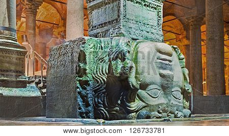 ISTANBUL TURKEY - JANUARY 21 2015: The inverted column base with Medusa head in Basilica Cistern to negate the power of the Gorgon's gaze on January 21 in Istanbul.
