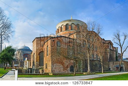 The Hagia Irene Orthodox Church with the minarets and dome of Hagia Sophia on the background these landmarks are preserved Byzantine Temples in Istanbul Turkey.